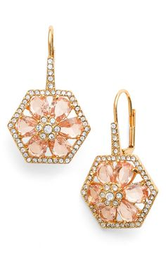 Sparkling crystals line the geometric frames of these versatile lever-back earrings centered with a floral motif of blushing-pink jewels.
