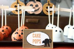Celebrations at Home created a Halloween treats table using adorable Halloween cake balls that look like jack-o'-lanterns and ghosts made by Candy Valley Cake Company.  Source: Celebrations at Home
