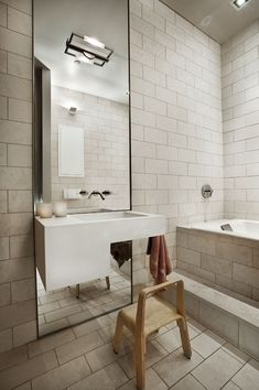 DHD Architecture + Interior Design in NYC - Union Square Loft Bathroom - Neutral colors + Large Mirror + Bathtub