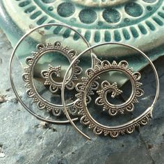 Beautiful and unique spiraled wave hoop earrings.