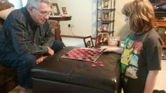 Sissy and Grandpa playing checkers... 12-21-16