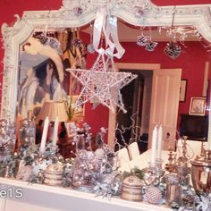 White Christmas mantlepiece arrangement in white and silver