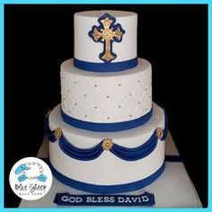 This three tiered fondant specialty cake features navy blue fondant swags, gold medallions, quilting, and an intricate navy blue and...