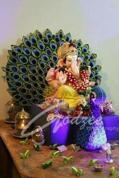 Ganesh decoration-quilling peacock Decoration Ideas Source by ideas ideas for ganpati