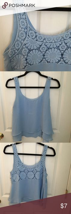 Blue tank top Super cute baby blue tank top with a lace back.. in perfect condition! mine Tops Tank Tops