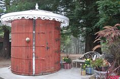 Eclectic Outdoor Water Tank Bathroom. So cool. Cost is $16,000, including plumping, labor, and materials. I want this.