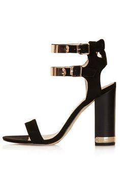 Black metal ankle strap sandals.