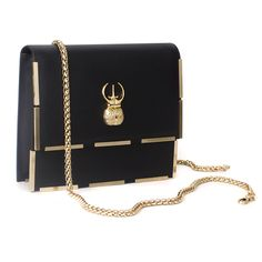 I'm totally in love with this BLISS nahkalaukku black leather handbag with a gold strap by Marja Kurki Fnnish designer . Finland