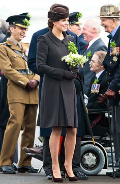 Working an all-brown ensemble and elaborate updo, Kate Middleton attends the St. Patrick's Day Parade in Aldershot on March 17.