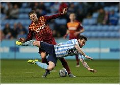 Coventry C 1 Bradford C 0 in April 2016 at the Ricoh Arena. Jamie Proctor brings down Romain Vincelot in League Ricoh Arena, Coventry, Bradford, Bring It On, Football, Running, Sports, Roman, Soccer