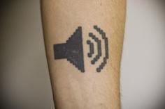Sound symbol geek tattoo on arm Tattoo Geek, Tech Tattoo, Nerdy Tattoos, Hp Tattoo, Cool Tattoos, Tatoos, Icon Tattoo, Tattoo Pics, Awesome Tattoos