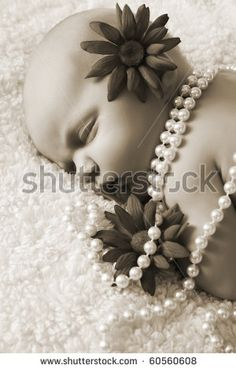 newborn girl with pearls