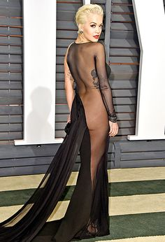 Rita Ora wears a risque underwear-less dress at the Oscars afterparties.