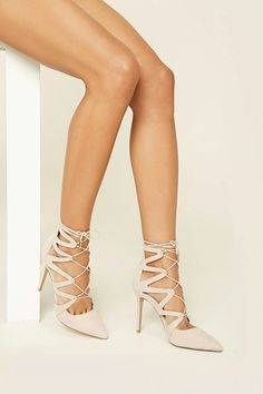 a28546eebbff A pair of faux suede stiletto heels featuring a strappy design