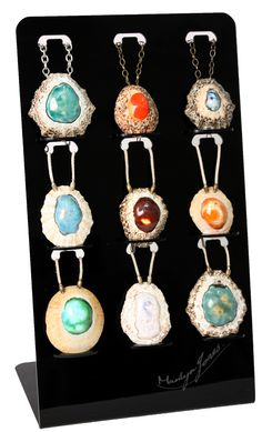 display of my new ocean tumbled limpet shell pendants on a more comtemporary display stand