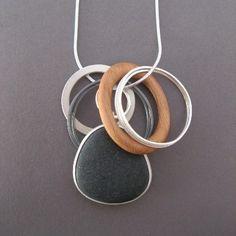 Pebble pendant with wooden hoop by Grace Girvan