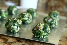 baked spinach & parmesan balls with Italian seasoned bread crumbs