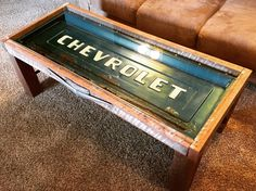 A personal favorite from my Etsy shop https://www.etsy.com/listing/291659461/chevy-cheverolet-tailgate-coffee-table