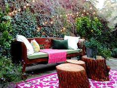 Perfect outdoor space - love the lights, tree trunks, pop of color in the rug