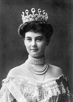 Grand Duchess Alexandra of Mecklenburg-Schwerin (born Princess Alexandra of Hanover) wears a large tiara topped with pear-shaped gemstones in a portrait, ca. 1903