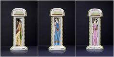 * M.Duchaussy - (1931) - Lampes-brûle parfum en biscuit émaillé polychrome de section & forme triangulaires, chaque panneau à décor d'une figurine en pied représentant l'Afrique Noire, l'Afrique du Nord, et l'Asie. Modèles édités à l'occasion de l'Exposition Internationale Coloniale de Paris en 1931