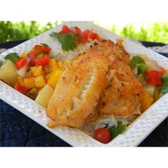 "LaWanna's Mango Salsa on Tilapia Fillets | ""A delicious fruity salsa topping to serve over fish or chicken, from a friend in Florida. I always use whatever that I have left in a mixed greens salad the next day. Use any kind of fish -- I use tilapia or salmon. The fish may also be grilled, which is what I prefer. If I can't find a good fresh pineapple, I will use canned pineapple tidbits."""