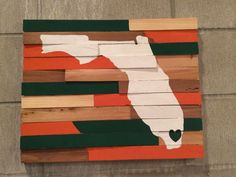 College Wall Hanging - University of Miami - Perfect for any Miami Hurricanes fan! This wall hanging is hand painted and handcrafted making each piece unique.