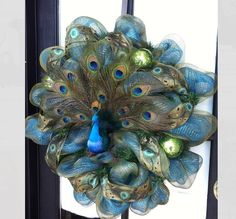 I would love to make this one day! I have a glass peacock I could use for the center.