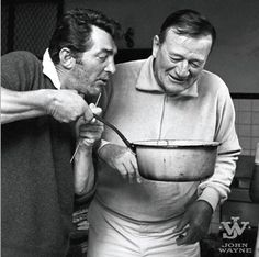 John Wayne and Dean Martin take a break from filming The Sons of Katie Elder (1965) to cook some pasta. Duke was also friends with another Rat Pack member, Frank Sinatra.