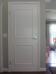 If you have a flat plain door like myself you could add some trim pieces creating the box on the door and some extra dimension, then give it a good paint!