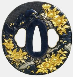 The tsuba, fuchi and kashira are all made with shakudo base metal with nanako ground. Flowering peonies are done in gold, among shakudo rock...