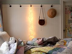 Hanging string lights and mis-matched bedding. LOVE. Credit // Alicia Paulson of Posie Gets Cozy.