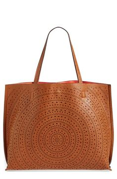 Free shipping and returns on Street Level Lasercut Reversible Faux Leather Tote at Nordstrom.com. A roomy faux-leather tote flips from perforated cognac to vibrant mandarin orange for ultimate styling versatility. An inner zip pouch provides a place to stash smaller items, so your essentials are easier to find when you need them.