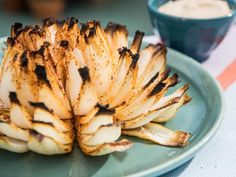 "Get Grilled Onion Blossom Recipe from Food Network: onions, sprinkled the ""petals"" with seasonings—Mrs dash & a little cayenne pepper, Drizzle of olive oil. Grilled on a piece of tinfoil for about minutes. Onion Blossom Recipe, Grilling Recipes, Cooking Recipes, Grilling Ideas, Healthy Recipes, Vegetable Recipes, Healthy Eats, Blooming Onion Recipes, Grilled Blooming Onion Recipe"
