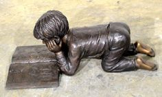 Place this bronze statue of a child reading a book in a place for quiet creativity. Sculpture Art, Reading Art, Statue, Book Art Sculptures, Sculpture, Art, Street Art