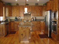 Knotty Alder cabinets are what I have in my house.   This is beautiful but Paul would want black countertops.  I think we make it work and still look fabulous.