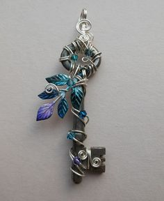 Lovely hand wrapped keys for pendants. This shop does beautiful work. I'd love to learn how to do this.