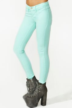 Mint colored skinny jeans with platform boots.
