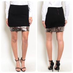 Black Mini Skirt with Gold and Silver Sequin Hem Add a little sparkle! This gorgeous skirt will make you glow inside and out. Wear it now with sandals and a tank and later with tights and boots. The skirt is made of 95% polyester/ 5% elastane. It is available in small, medium, and large. Boutique Skirts Mini