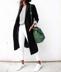 white pants, oversized black coat, green bag, white sneakers, flowy gray top. Perfect all outfit in the city