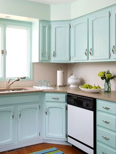 Fresh & Functional Kitchen- Big Style-  Pay attention to the details and a small kitchen can surprise you. Fun cabinet hardware, bright colors, and a few accessories breathe life into any space, big or small. While there is strength in numbers, a small space needs only a few extras to keep the room clutter-free and fresh.