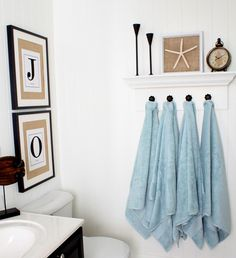 "Love it! I prefer hanging towels to towel rods, but it's hard to get hooks on the wall in a stud. This way you can hang the ""shelf"" using the studs and the hooks will be secure in the wood of the shelf."