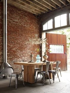Exposed brick wall, wood dining table, metal chairs, antler chandelier, intriguing space Dining Room Design By Marais Industrial Living, Industrial Interiors, Industrial Style, Industrial Design, Industrial Industry, Vintage Industrial, Loft Interior, Interior Architecture, Interior And Exterior