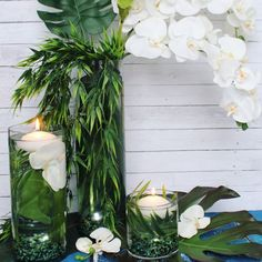 Submerged Flower Centerpieces are a gorgeous and easy arrangement for any DIY bride. Real touch artificial flowers and leafs are a great way to create lasting,