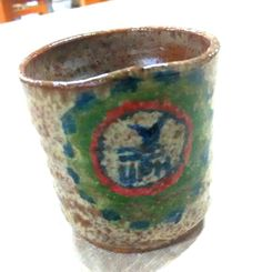 Result of the refired cup in oxidation electric kiln, that was fired in the raku yesterday.