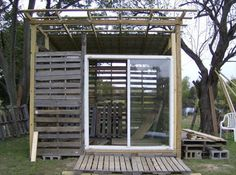 Is there an idea here for my outside shower? could pallet wood be the top? how bout the use of a storm door?