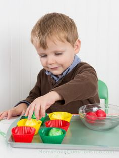 """A is for apples Tot Trays: Matching - Have 6 ping pong balls (2 red, 2 yellow, and 2 green) in a bowl. Match """"apples"""" (ping pong balls) in same colored silicone cupcake liners."""