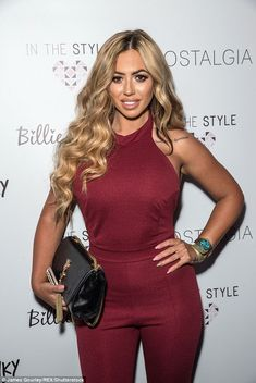 Dressed to the nines:The Geordie Shore star chose a deep red halter-neck jumpsuit for the...