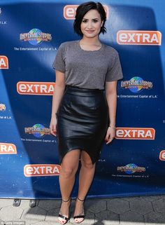 Demi Lovato shows off legs and curvy figure in leather pencil skirt #dailymail
