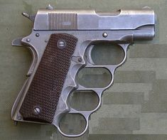 I finally found a short-barrel 1911 I would consider buying!  M1911A1-Knuckles-1911-Pistol 1911 Pistol, Cool Guns, Destruction, Military Equipment, Weapons, Crossbow, Gears, Tactical Gear, Tumblr
